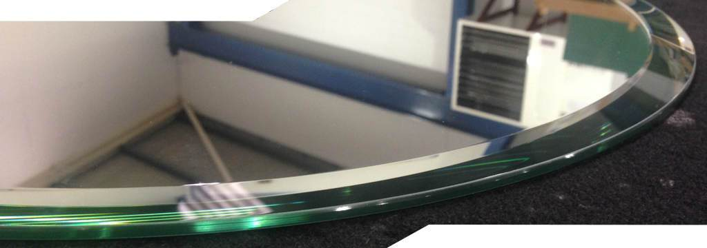 bevelled mirror circle showing the quality of the finishing we produce