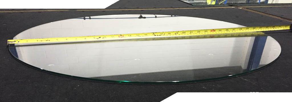 glass oval with a polished edge laying flat