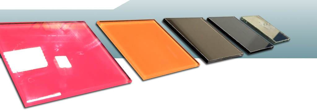 photo of different glass samples laid out in line - showing painted, tinted and clear