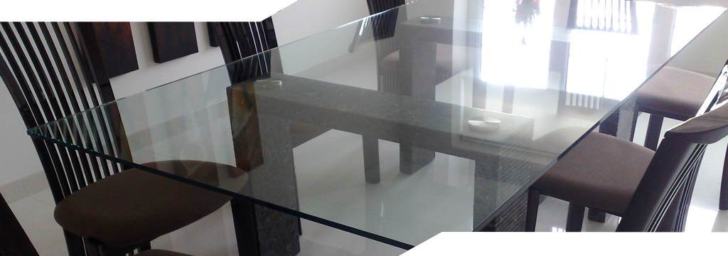 large glass table top laying on stone legs
