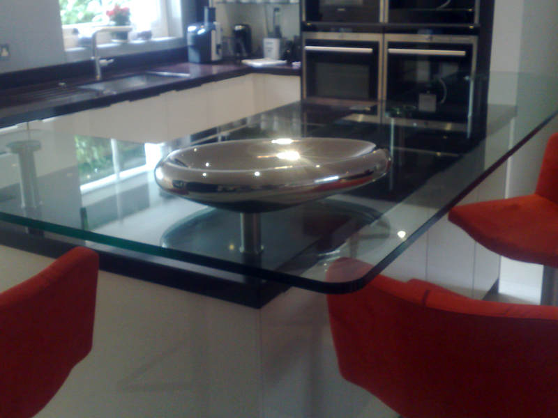 19mm Toughened Top with UV Bonded stainless steel fixings.