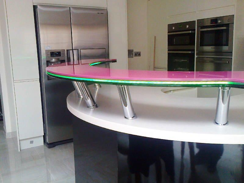 Breakfast Bar made to suit existing worktop, mounted with UV bonded metal fixings to the underside of the glass, keeping the top surface free of fittings.