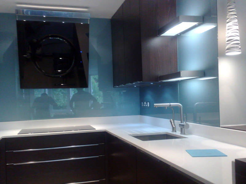 Coloured Splashbacks finished in Sea Blue, taken behind all the existing kitchen installations.