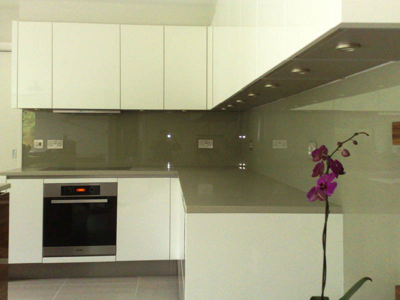 Backsplashes made to cover the full length of the worktop run and return, matched to existing worktop.