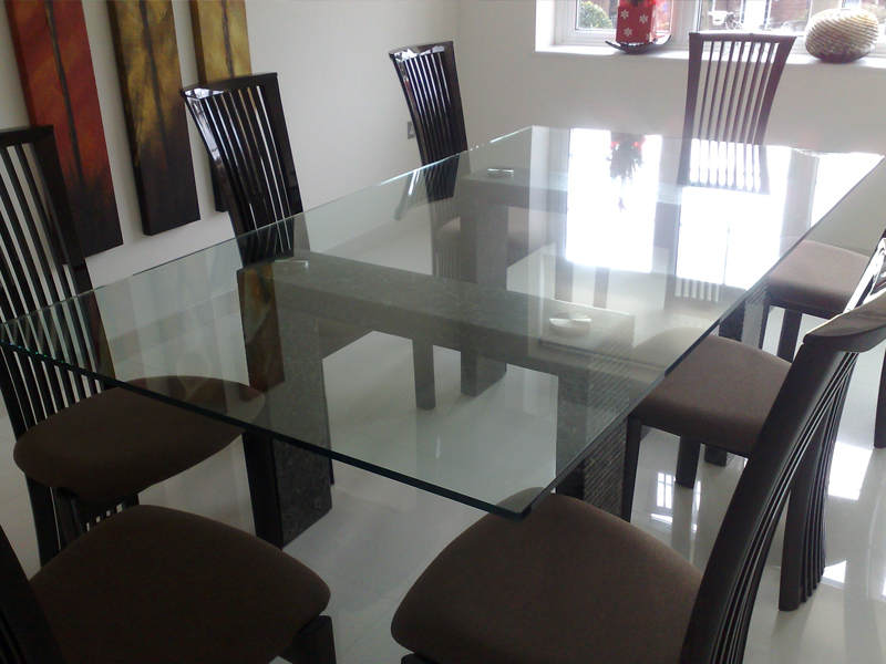 Superb Photo Of A 15mm Thick Glass Table Top Fitted To Stone Legs