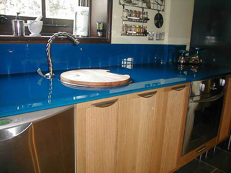 Blue Worktop with matching glass upstands fitted with LED lights.
